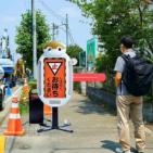 ウイズ・アフターコロナに対応したコミュニケーション能力が高い交通誘導警備ロボ